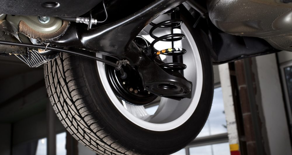 Shock absorbers and rear tire of a modern car, low-angle view